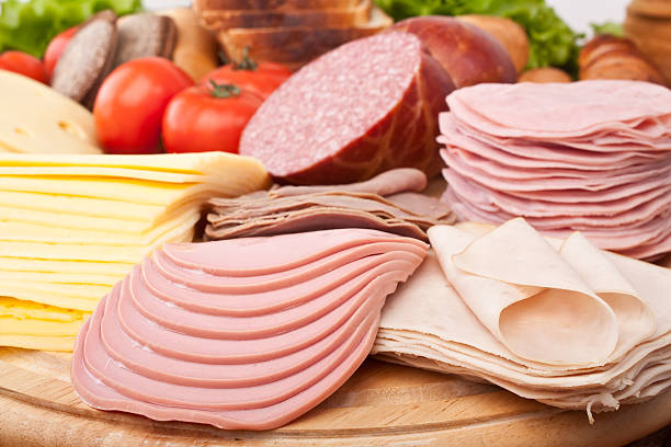big group of meat, cheese and vegetables stock photo