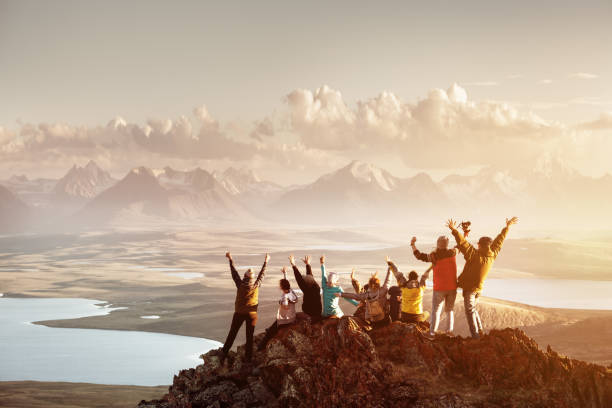 Big group of people success mountain top stock photo