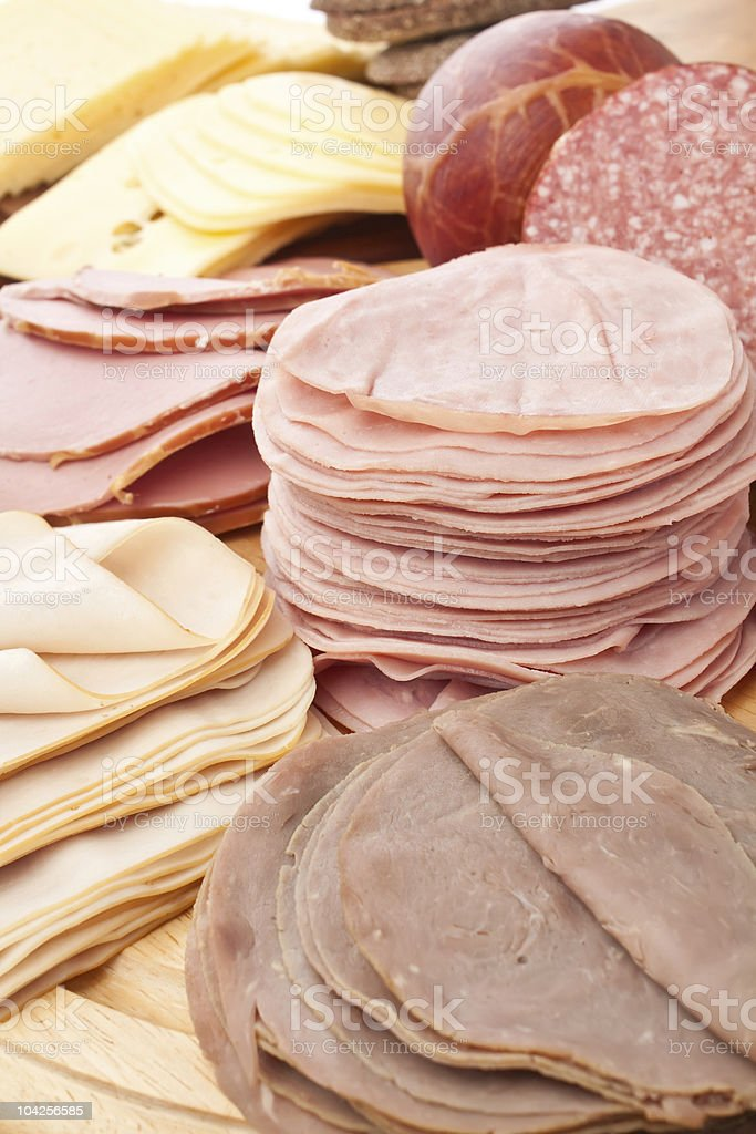 big group of thinly sliced meat and cheese royalty-free stock photo