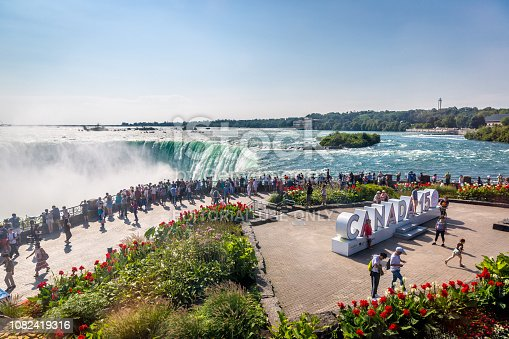 Niagara, Canada - Sep 21th 2017 - Big group of tourists looking to the Niagara Falls with the