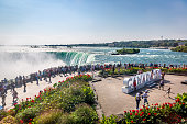 Niagara, Canada - Sep 21th 2017 - Big group of tourists looking to the Niagara Falls with the \
