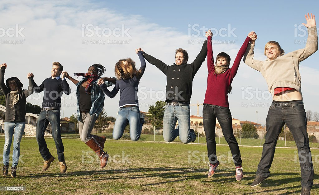 Big group of young jumping people - Student leisure royalty-free stock photo