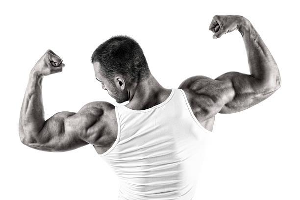 big pistolas - hombres grandes musculosos fotografías e imágenes de stock