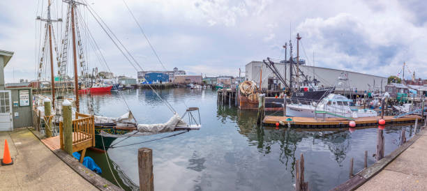 big halls and boats in the harbor area for the lobster fishing industry in Gloucester Gloucester: big halls and boats in the harbor area for the lobster fishing industry in Gloucester, USA. gloucester massachusetts stock pictures, royalty-free photos & images