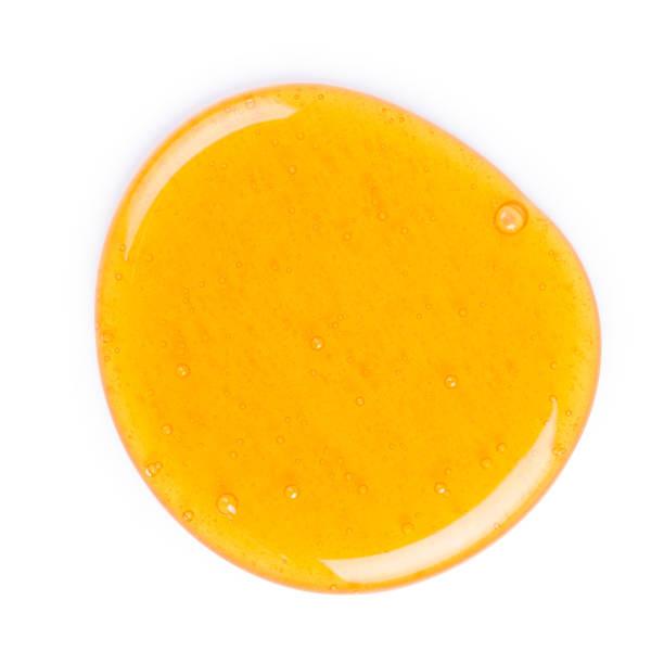 big honey drop isolated - mel imagens e fotografias de stock