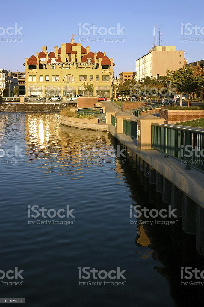 A big house is being reflected on the river stock photo
