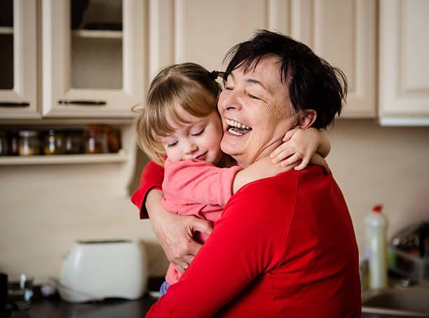 Big hug - grandmother with granddaughter stock photo