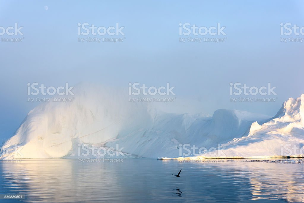 Big iceberg on the arctic ocean at Ilulissat fiord stock photo