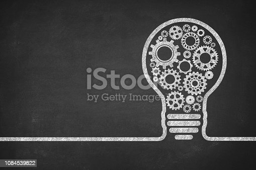 Big idea light bulb with gears on blackboard