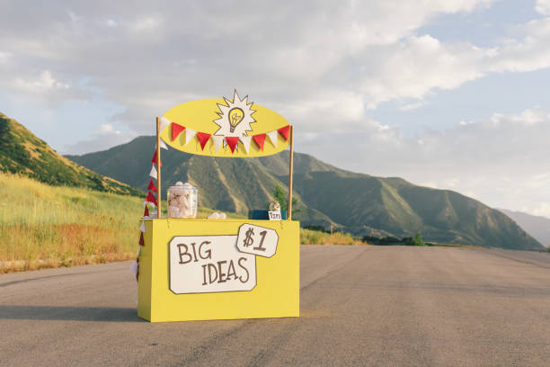 Big Ideas Lemonade Stand One and all come by the Big Ideas Lemonade Stand for innovative and fresh ideas located on a rural road in the mountains of Utah. For just one dollar, any businessperson would take advantage of such a sale. These bright ideas can brighten and enlighten any business owner who is looking to break new ground for their company. lemonade stand stock pictures, royalty-free photos & images