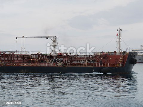 Big Industrial cargo ship on the water. Merchant ship entering port. Logistics and transport of international container cargo ship. Freight transport, Sea transport.