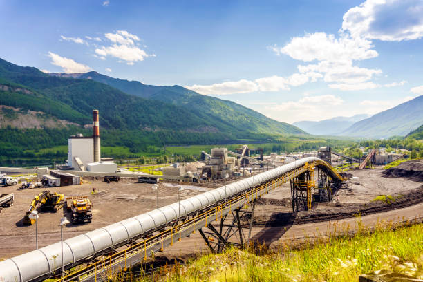 Big industrial infrastructure among mountains in Canada stock photo