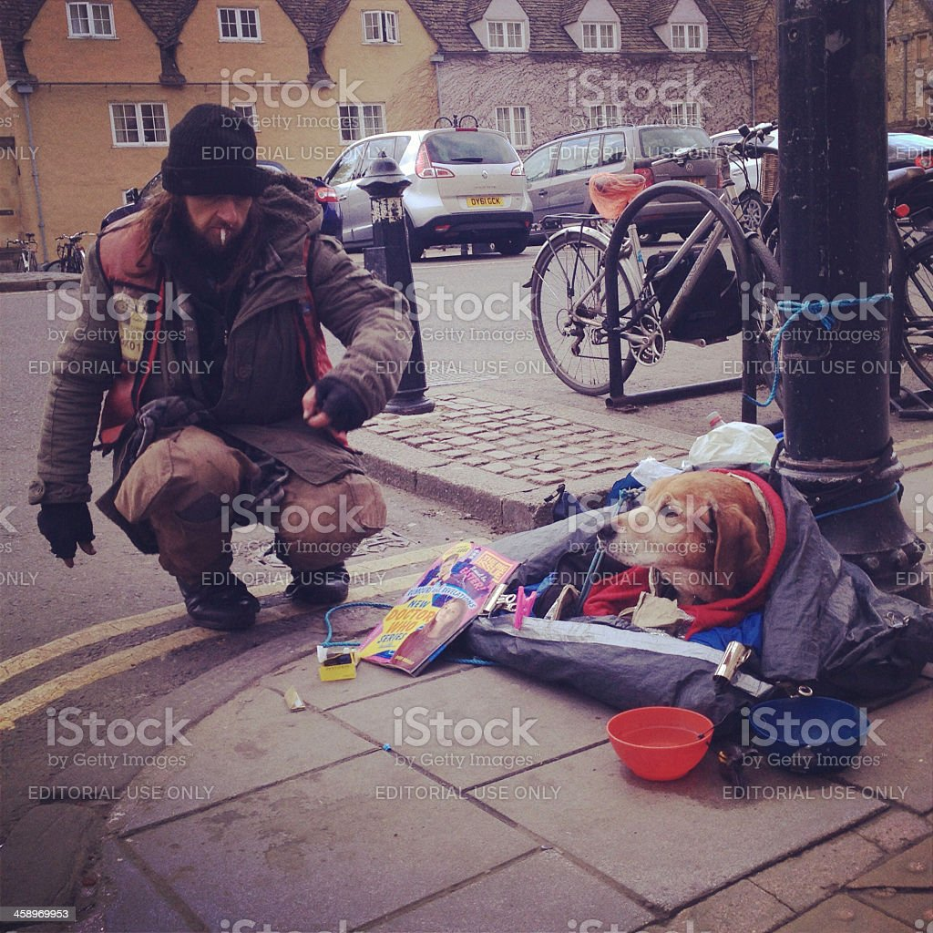 Big issue seller and dog royalty-free stock photo