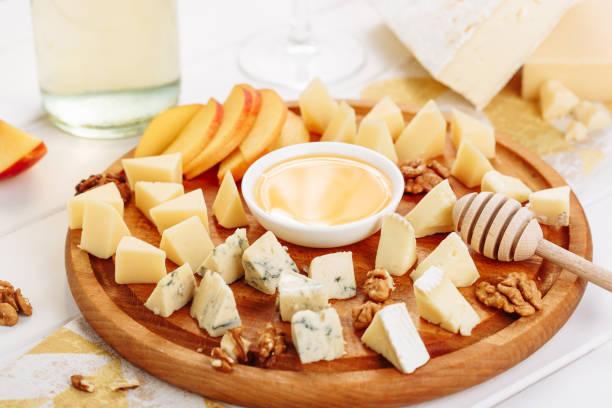 Big Italian Cheese Board Gourmet Food with Honey stock photo