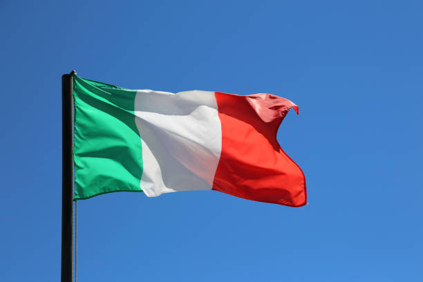 big italian flag waving in blue sky - milan fiorentina foto e immagini stock