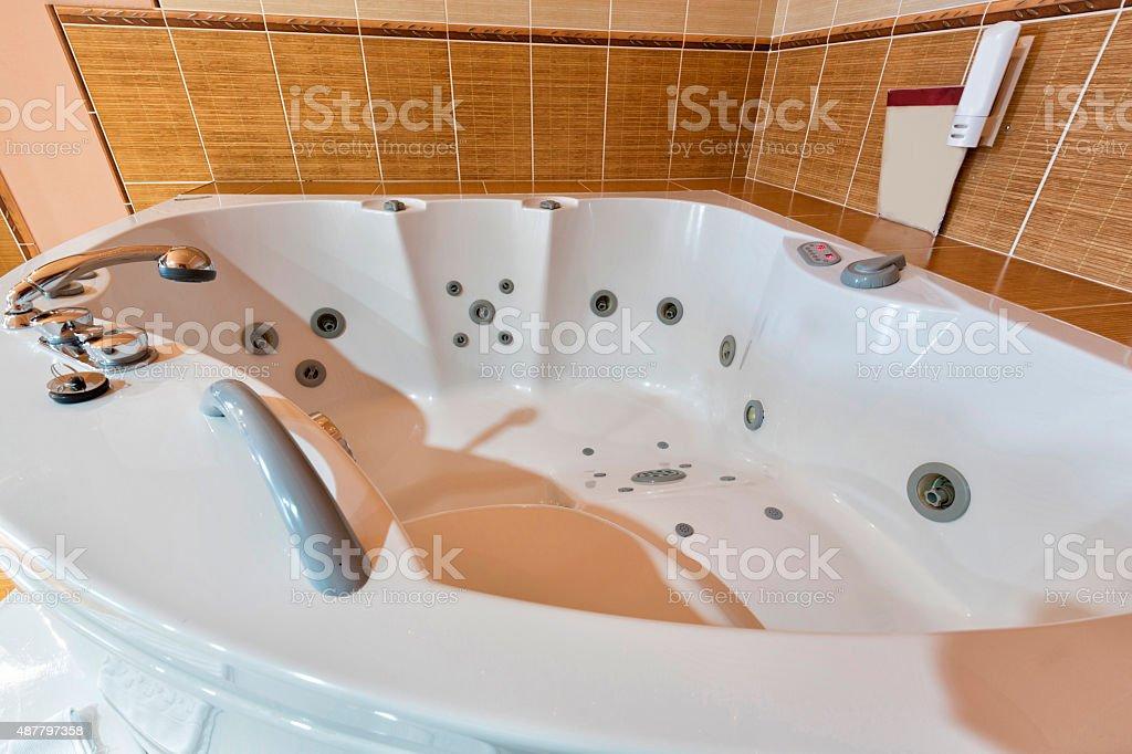 Big jacuzzi in bathroom stock photo
