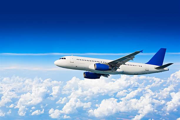 big jet airplane above clouds - 亂流 個照片及圖片檔
