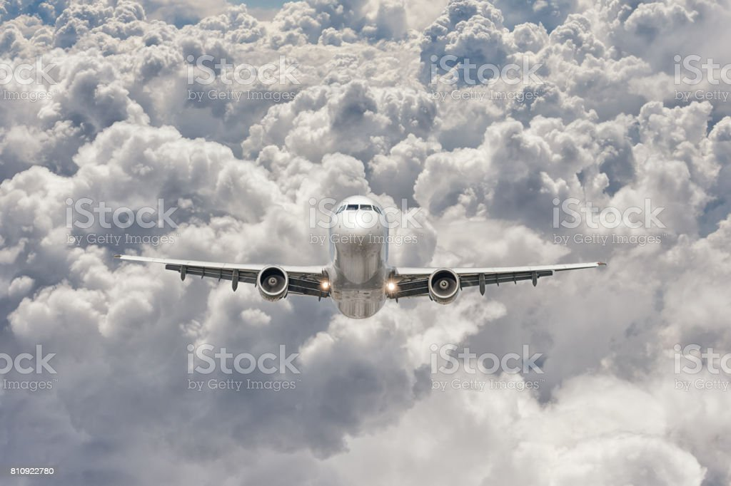 big jet plane flying through the clouds stock photo