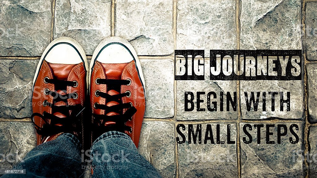 Big journeys begin with small steps, Inspiration quote stock photo