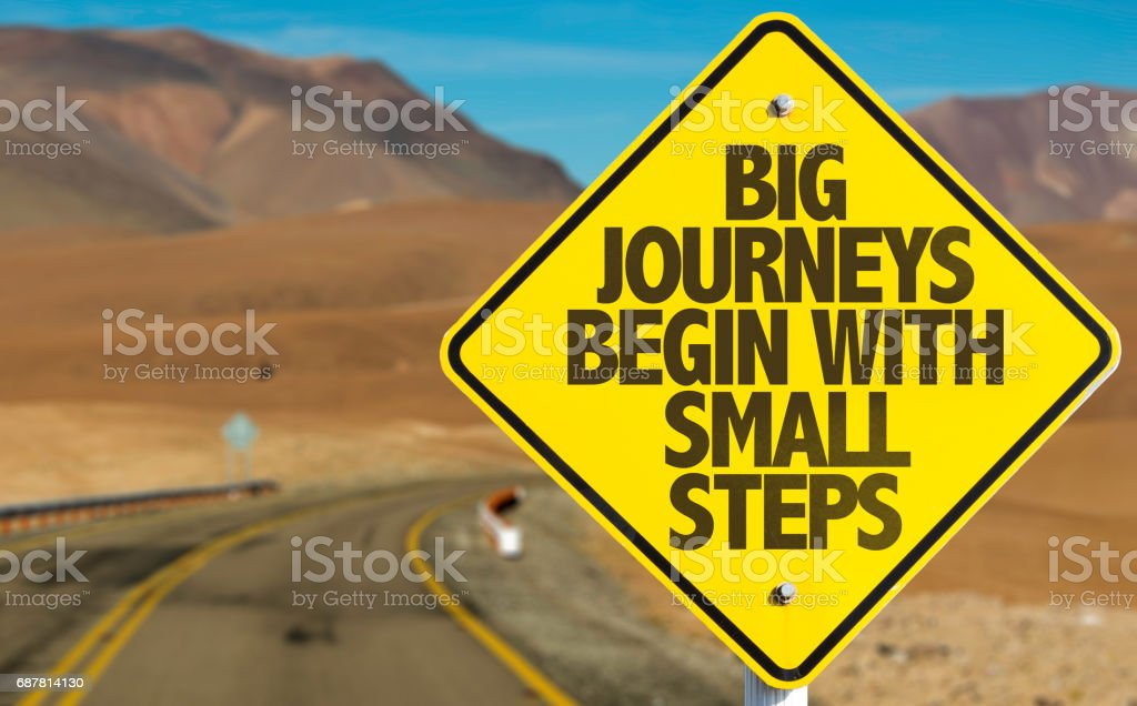 Big Journeys Begin With Small Steps sign with sky background stock photo