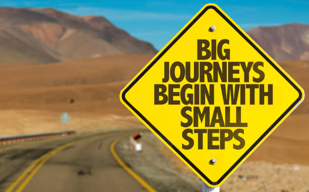 big journeys begin with small steps sign with sky background - images no copyright foto e immagini stock