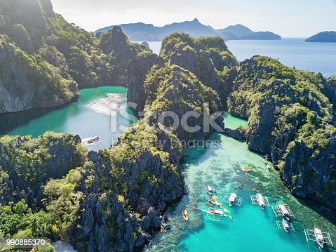 Famous Big Lagoon and Small Logoon on Miniloc Island with filipino Balangay Tour Boats and Kayaks. Aerial Drone Point of View. Miniloc Island, Mimaropa, El Nido, Palawan, Philippines, Asia