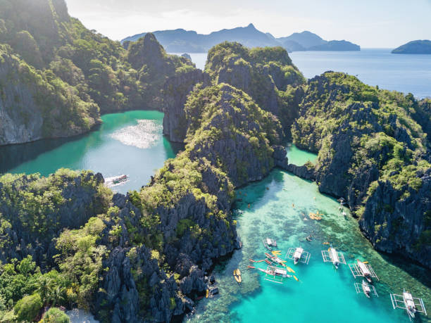 big lagoon palawan miniloc island el nido philippines - philippines stock photos and pictures