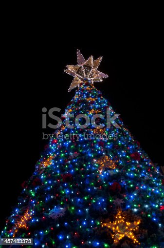 865140324 istock photo Big Lighten up Christmas tree 457483373
