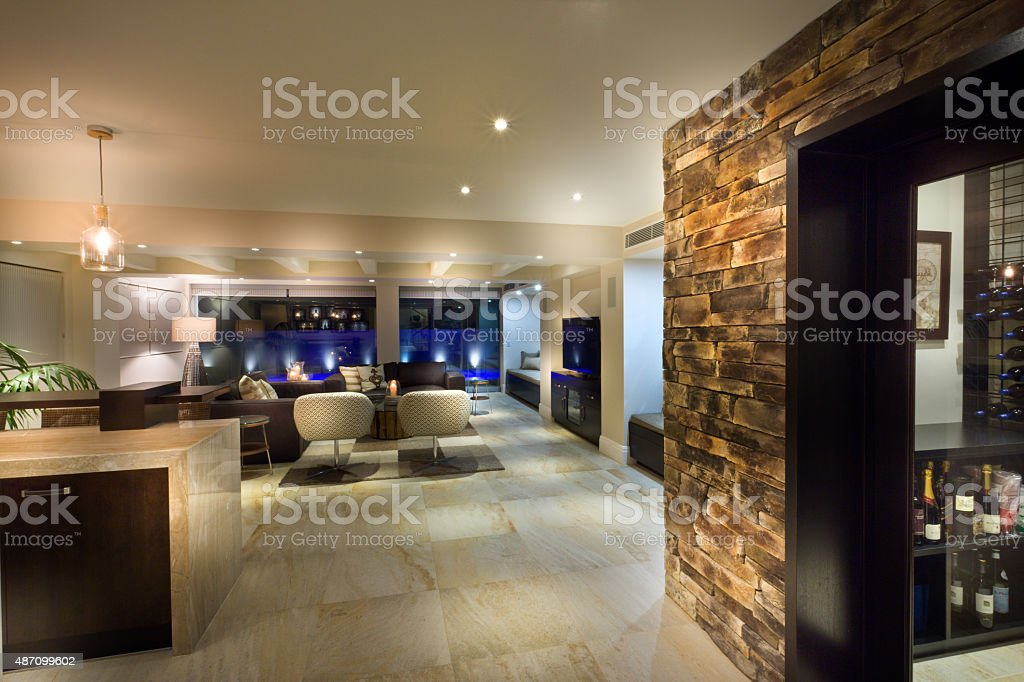 Big living room with a wine cellar stock photo
