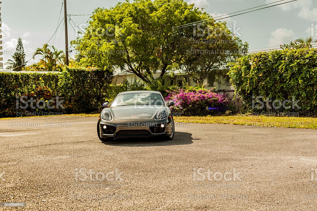 Big long shot Porsche Cayman in residential area stock photo