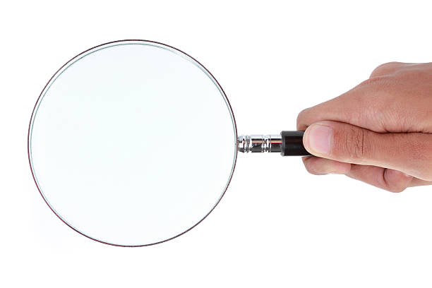 Big magnifying glass Big magnifying glass in hand low scale magnification stock pictures, royalty-free photos & images