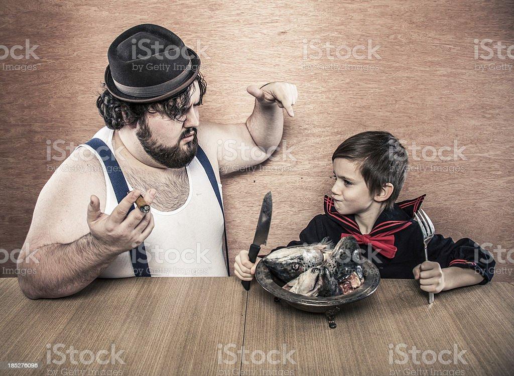 Big Man, Sailor Boy, Eating Fish Heads, Holding a Knife stock photo