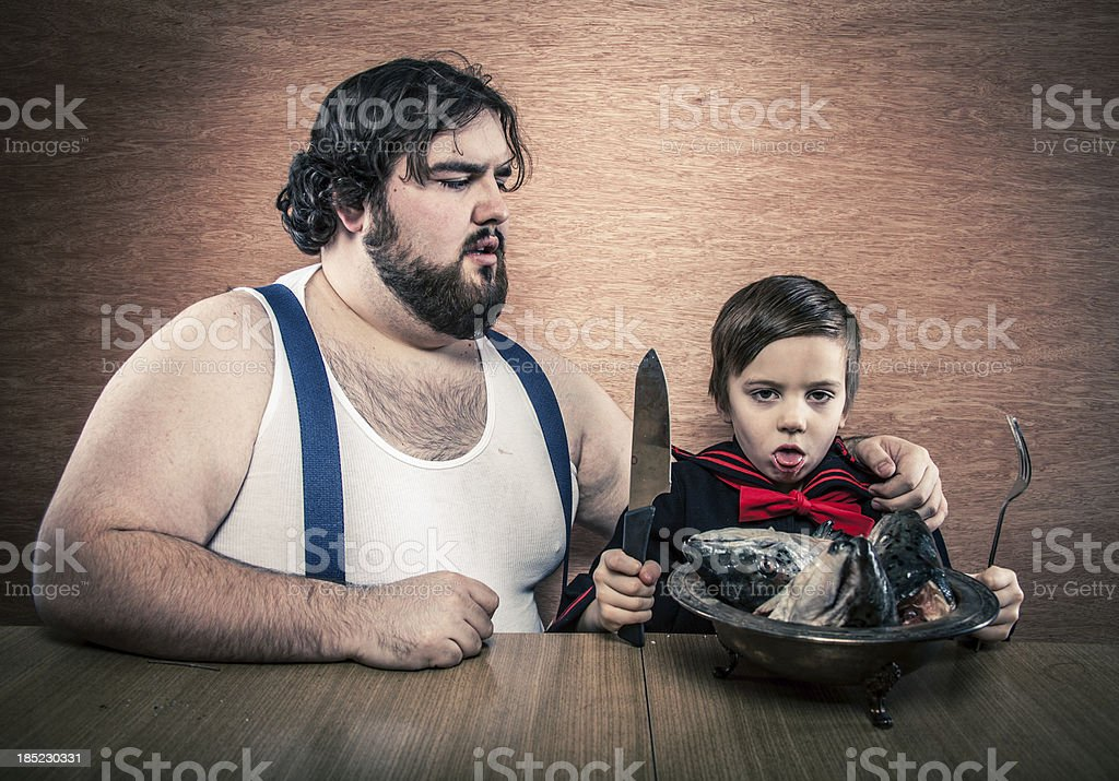 Big Man, Sailor Boy, Eating Fish Heads, Nausiated Expression stock photo