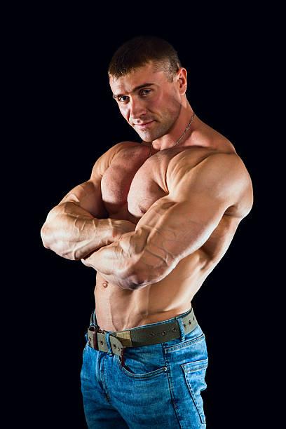 big man with huge muscules. bodybuilding, sports, gym. healthy l - hombres grandes musculosos fotografías e imágenes de stock