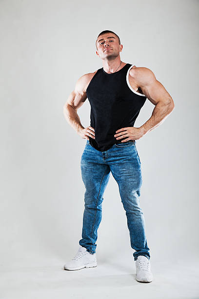 big man with huge muscules. bodybuilding, sports, gym. - hombres grandes musculosos fotografías e imágenes de stock