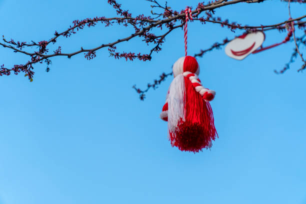 Big Martenitsa on a tree with blue sky in the background stock photo