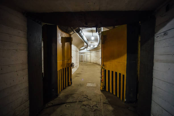 Big massive hermetic metal armored door of soviet military bunker Big massive hermetic metal armored door of soviet military bunker. bomb shelter stock pictures, royalty-free photos & images