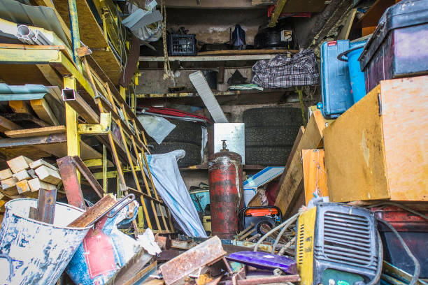 Big mess in an over stuffed suburban garage. Big mess in an over stuffed suburban garage. greed stock pictures, royalty-free photos & images