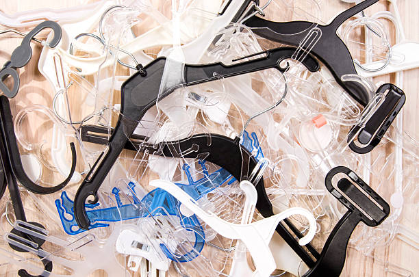 Big messy pile of hangers on the floor. stock photo