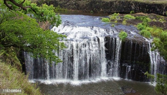 Big Millstream Falls, plunges over a basalt lava flow, in the Millstream Falls National Park, Ravenshoe, Atherton Tablelands, Australia