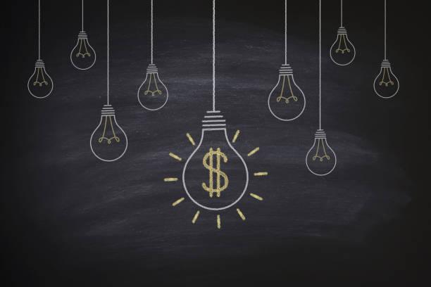 Big money bulbs on blackboard stock photo