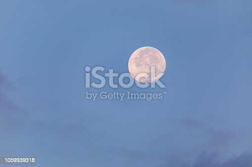 Big moon at morning with a light clouds