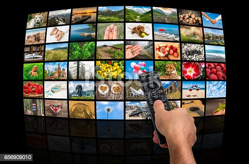 1032516726 istock photo Big multimedia broadcast video wall with remote control 656909010