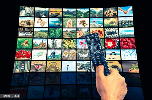 1032516726 istock photo Big multimedia broadcast video wall with remote control 656912004