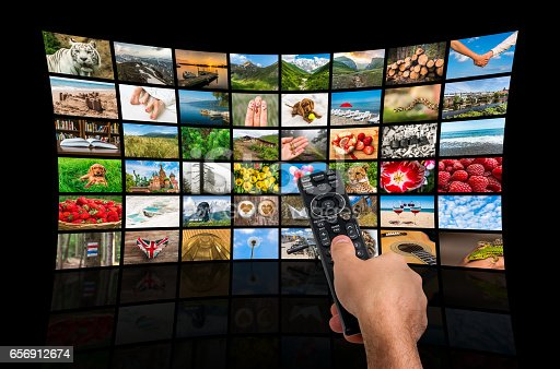 1032516726 istock photo Big multimedia broadcast video wall with remote control 656912674