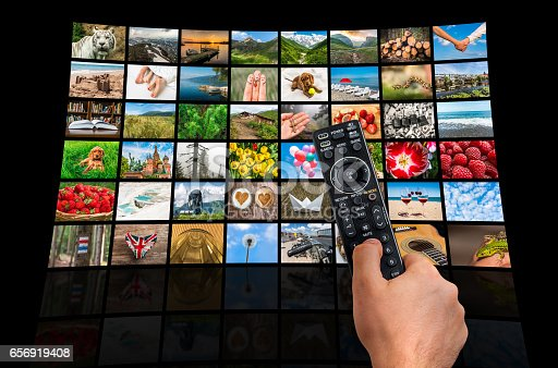 1032516726 istock photo Big multimedia broadcast video wall with remote control 656919408