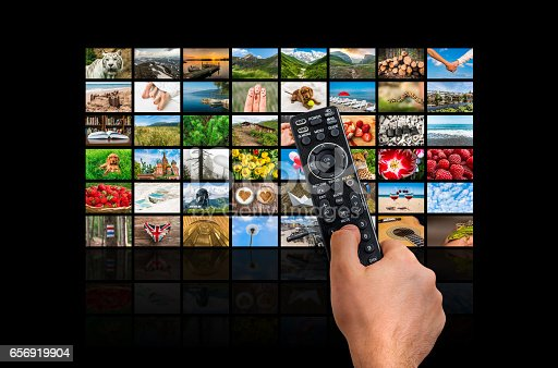 1032516726 istock photo Big multimedia broadcast video wall with remote control 656919904
