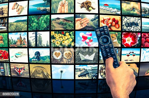 1032516726 istock photo Big multimedia broadcast video wall with remote control 656920028