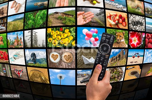 1032516726 istock photo Big multimedia broadcast video wall with remote control 656922484