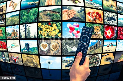 1032516726 istock photo Big multimedia broadcast video wall with remote control 656923198